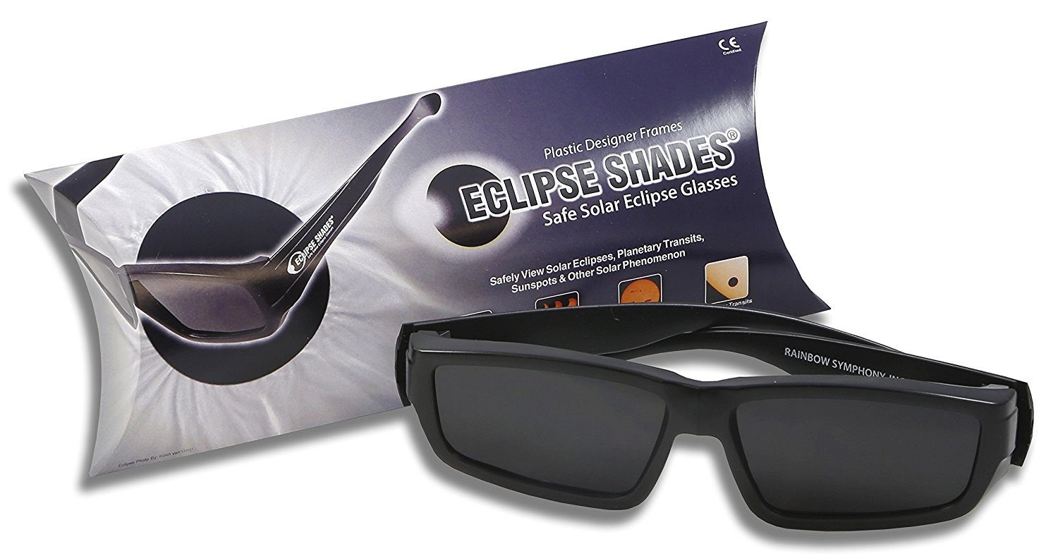 A pair of plastic solar eclipse sunglasses shown in front of its packaging.