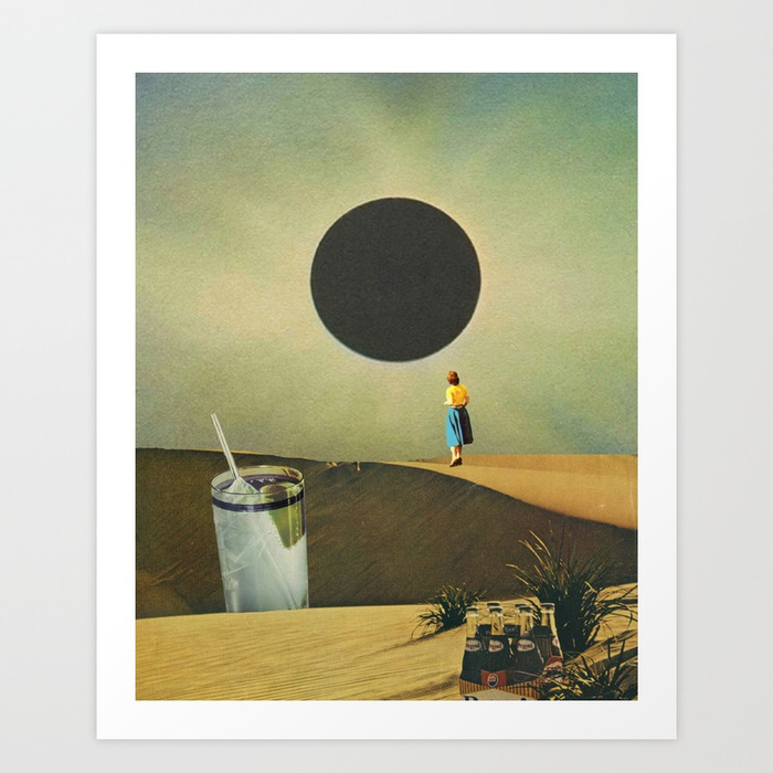 A women from the 50s stands upon sand dunes looking at an eclipse. In the foreground is a cocktail and soda.